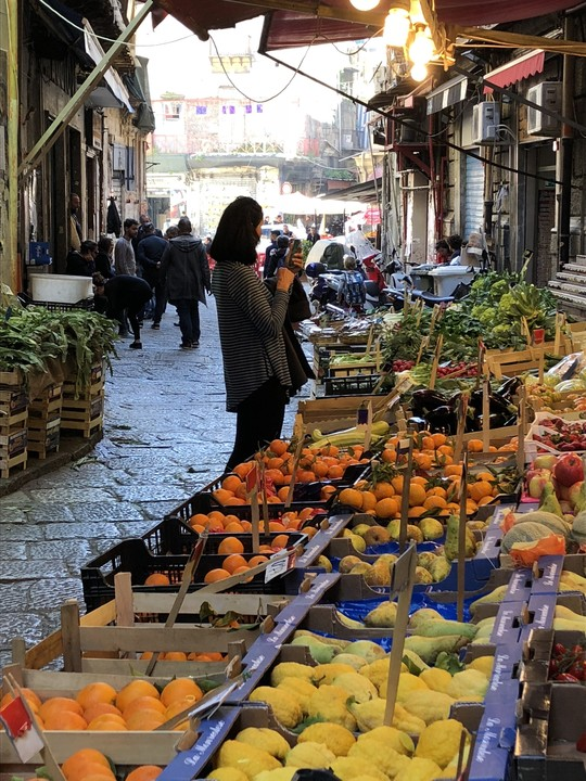 Woman shopping in an open market for vegetables