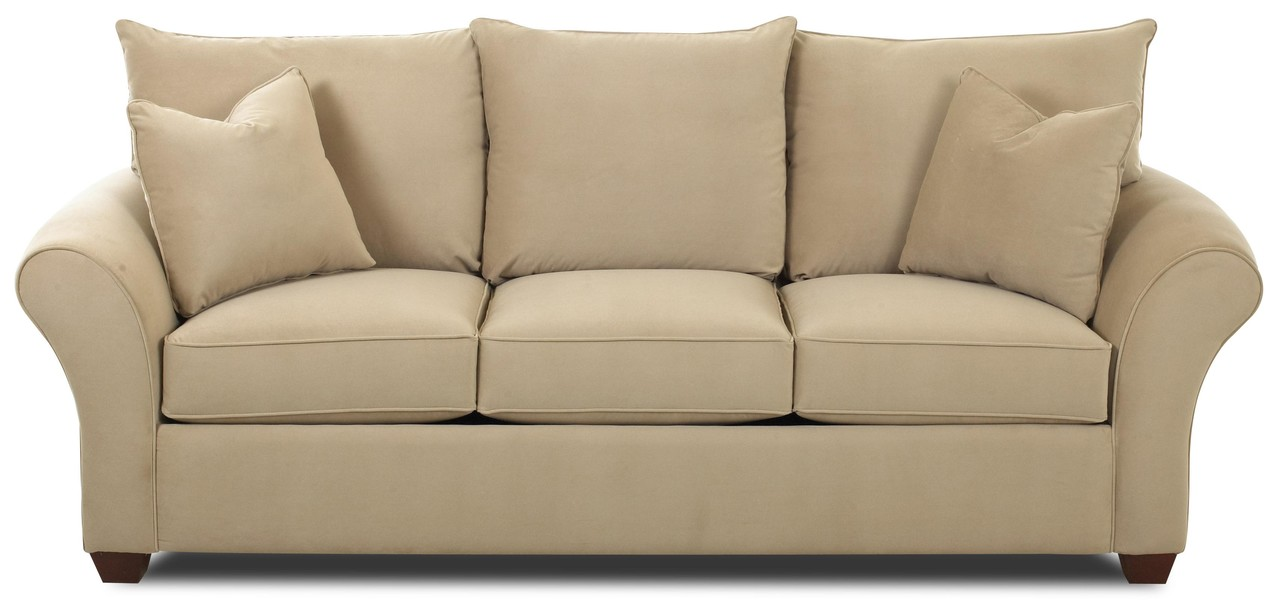 Brown couch with three cushions