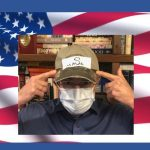 "America Responds to Pandemic Coronavirus! Image of Dr. Katz with a facemask and a ""Make America Safe Again"" baseball cap, in front of the US flag"