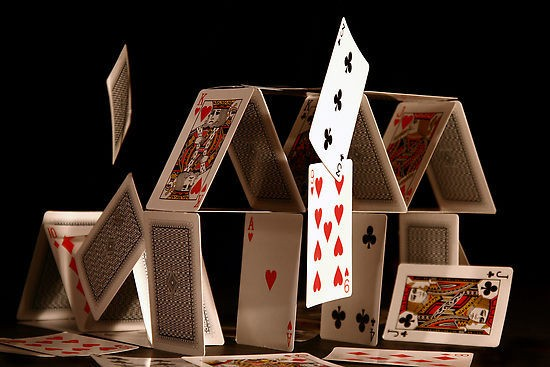Image of falling house of (playing) cards.