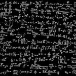 Blackboard filled with mathematical equations.