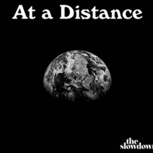 "Black and white ""At a Distance: The Slowdown"" Logo with orbiting earth on black background"