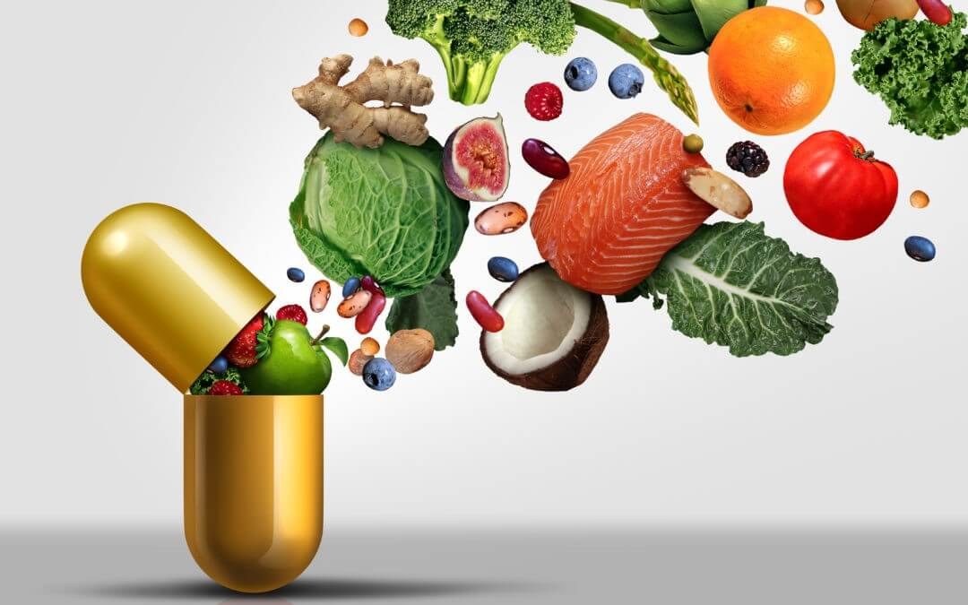 A golden pill capsule opens and out spills a variety of healthy foods, including veggies, beans and fruit