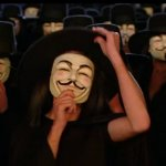 """Several people at night wearing black hoods and clothing and """"Anonymous"""" masks."""
